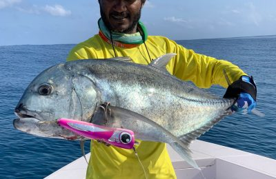 Bonda holding a trevally fish - Photo: Addu sports fishing